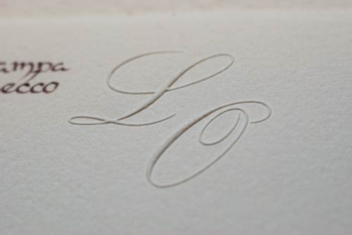 Close-up of the embossed initials